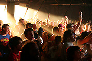 Ravers dancing in a sunlit Bays tent, Glade Festival, UK 2005