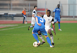 Uros Celcer #3 of ND Gorica vs. Opoku Aborah Stanley #26 of Mura 05 during football match between ND Gorica and ND Mura 05 in 20th Round of PrvaLiga NZS 2012/13 on November 24, 2012 in Nova Gorica, Slovenia. (Photo By Ales Cipot / Sportida)