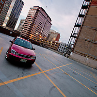 My car parked in lot at 11th and Baltimore, downtown Kansas City, MO.