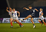 Connacht centre Kyle Godwin kicks clear as Sale Sharks centre Rohan Janse van Rensburg tries to block the kick during Sales victory 20-10 in the  European Challenge Cup Quarter Final match in Eccles, Greater Manchester, United Kingdom, Friday, March 29, 2019.  (Steve Flynn/Image of Sport)
