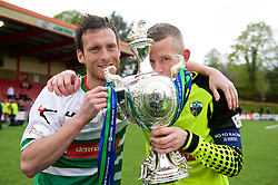 NEWTOWN, WALES - Saturday, May 2, 2015: The New Saints Matty Williams and captain and goalkeeper Paul Harrison celebrate with the trophy after winning the FAW Welsh Cup final match at Latham Park against Newtown. (Pic by Ian Cook/Propaganda)