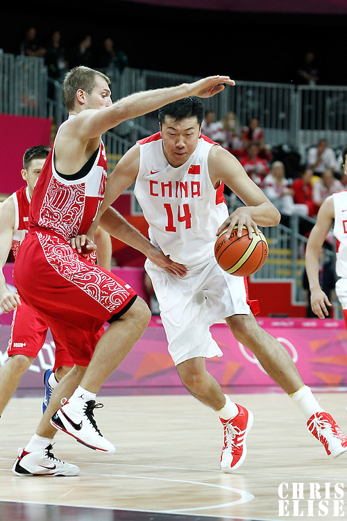 31 July 2012: China Zhizhi Wang dribbles during the 73-54 Russia victory over China, during the men's basketball preliminary, at the Basketball Arena, in London, Great Britain.