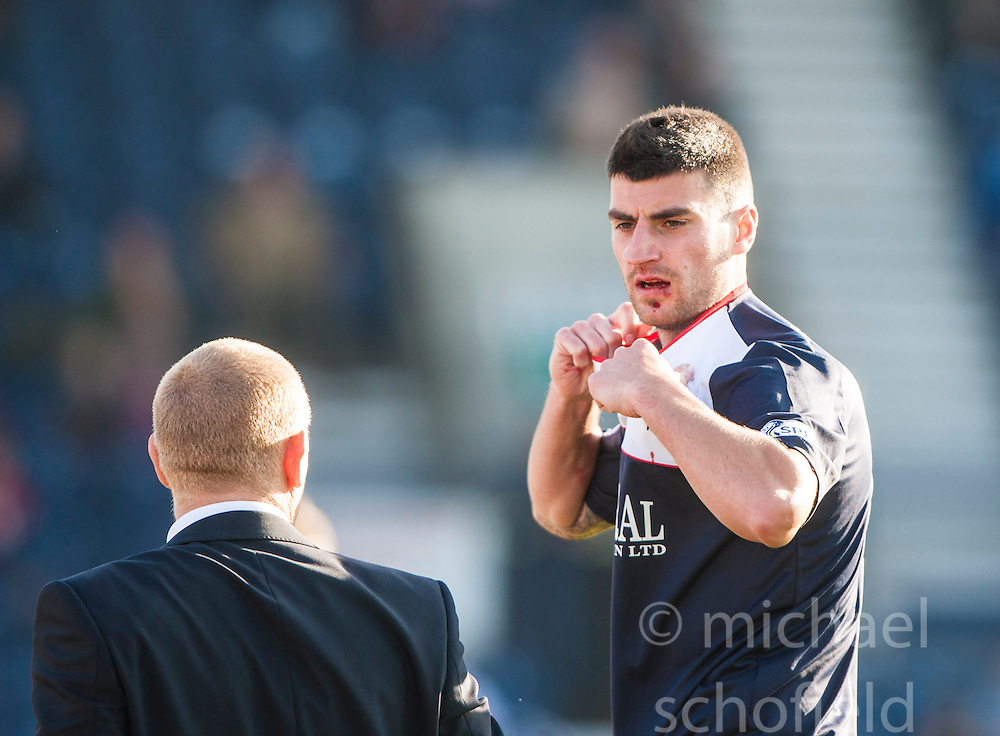Falkirk's manager Gary Holt with Falkirk's Jonathan Flynn with blood on his face.<br /> Raith Rovers 1 v 1 Falkirk, Scottish Championship 28/9/2013.<br /> &copy;Michael Schofield.