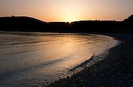Sunrise over Avlaki Beach on the northeast coast of Corfu, The Ionian Islands, The Greek Islands, Greece, Europe
