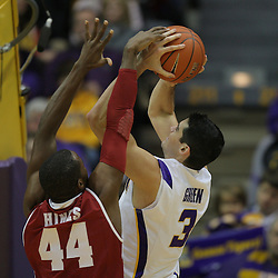 Jan 09, 2010; Baton Rouge, LA, USA; LSU Tigers forward Garrett Green (3) shoots over Alabama Crimson Tide forward Chris Hines (44) during the second half at the Pete Maravich Assembly Center. Alabama defeated LSU 66-49.  Mandatory Credit: Derick E. Hingle-US PRESSWIRE