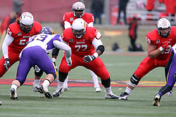 06 December 2014:  Normal Illinois.  Mark Spelman, Kyle Avaloy, Michael Liedtke line up in front of Tre Roberson and take on Karter Schult during a 1st round FCS NCAA football game between the Panthers of Northern Iowa and the Redbirds of Illinois State in Hancock Stadium.  Illinois State won the game 41-21.