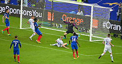 PARIS, FRANCE - Sunday, July 3, 2016: Iceland's Kolbeinn Sigthórsson scores the first goal against France's goalkeeper Hugo Lloris during the UEFA Euro 2016 Championship Semi-Final match at the Stade de France. (Pic by Paul Greenwood/Propaganda)