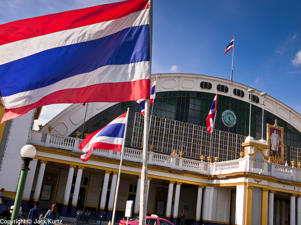 11 JULY 2011 - BANGKOK, THAILAND:  Hua Lamphong Grand Central Railway Station, officially known as the Bangkok Grand Central Terminal Railway Station, is the main railway station in Bangkok, Thailand. It is located in the center of the city in Pathum Wan District, and is operated by the State Railway of Thailand. The station was opened on 25 June 1916, after six years' construction. The station was built in an Italian Neo-Renaissance style, with decorated wooden roofs and stained glass windows. The architecture is attributed to Turin-born Mario Tamagno, who, with countryman Annibale Rigotti made a mark on early 20th century public building in Bangkok. The pair also designed Bang Khun Prom Palace (1906), Ananda Samakhom Throne Hall in The Royal Plaza (1907-15) and Suan Kularb Residential Hall and Throne Hall in Dusit Garden, among other buildings..There are 14 platforms and 26 ticket booths. Hua Lamphong serves over 130 trains and approximately 60,000 passengers each day. Thailand has the most advanced rail system in Southeast Asia and trains from Hua Lamphong serve all corners of the Kingdom.       PHOTO BY JACK KURTZ