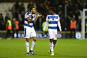 QPR midfielder Jordan Cousins (8) celebrates his side's 3-2 victory with QPR midfielder Ebere Eze (10) after the EFL Sky Bet Championship match between Queens Park Rangers and Brentford at the Loftus Road Stadium, London, England on 10 November 2018.