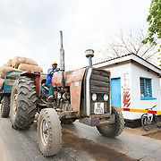 CAPTION: A tractor arrives on the weighing bridge with a trailer load of raw cotton. From here, it will proceed to the ginnery, where the cotton will be processed. LOCATION: Great Lakes Ginnery, Mgabu, Chikwawa, Malawi. INDIVIDUAL(S) PHOTOGRAPHED: Thenford Rodgers.