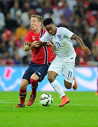 England's Raheem Sterling (Liverpool) battles for the ball - Photo mandatory by-line: Joe Meredith/JMP - Mobile: 07966 386802 - 3/09/14 - SPORT - FOOTBALL - London - Wembley Stadium - England v Norway - International Friendly