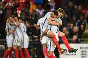 England defender John Stones is held up by England defender Kyle Walker after England scores a goal (1-0) during the FIFA World Cup Qualifier match between England and Slovenia at Wembley Stadium, London, England on 5 October 2017. Photo by Martin Cole.