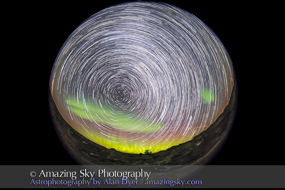 A composite stack of 198 images creating a circumpolar star trail image of the entire sky, with the motion of the stars and the Northern Lights over an hour recorded onto one frame. <br /> <br /> The 8mm fish-eye lens take in almost all the sky, with the camera aimed northeast to the centre of the auroral arc, with Polaris, the centre of the sky&rsquo;s rotation, at left. The scene is at Dinosaur Provincial Park in Alberta, from September 11, 2015. <br /> <br /> Each exposure was 20 seconds at f/3.5 with the Sigma 8mm lens and at ISO 6400 with the Canon 6D. The ground comes from a stack of 16 images taken early in the sequence turned into a smart object and mean combined with Mean stack mode, to average out and smooth noise. The sky comes from 198 exposures, Lighten stacked using the Advanced Stacker Actions from StarCircleAcademy.com.