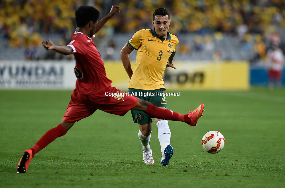 13.01.2015.  Sydney, Australia. AFC Asian Cup Group A. Australia versus Oman. Australian defender Jason Davidson gets his shot away before the block. Australia won the game 4-0.