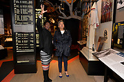 Photo ©Suzi Altman 12/5/17 Jackson,MS Pamela D.C. Junior, Director of the Mississippi Civil Rights Museum, left,  gives Judy Meredith, James Meredith's  wife a private tour of the museum before its official opening on Saturday Dec. 9th. They are seen viewing hte lynching wall with the KKK robe in the bacground.  Pictued is a KKK, Klu Klux Klan robe on dislay, in the new Mississippi Civil Rights Museum, the robe and mask were found in a Jackson MS. home. President Trump is expected to attend the opening of the Mississippi Civiil Rights and History Museums. Protests are planned in response to President Trumps announced attendance of the opening of the Civil Rights Museum. Photo©SuziAltman