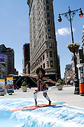 Brandy Norwood rides a wave during the #VisitAnaheim in 3D event in the Flatiron District in New York City, New York on June 24, 2015.