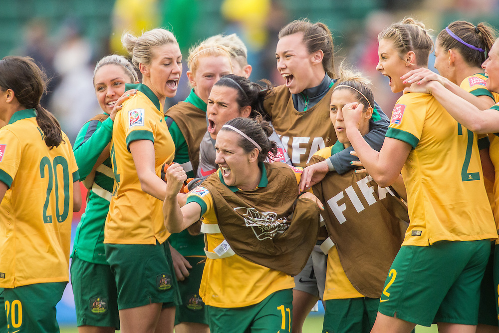 Australia's Lisa De Vanna (C) and her teammates celebrate after their 1-1 tie with Sweden in the final match of their FIFA Women's World Cup Group D round at Commonwealth Stadium in Edmonton, Canada on June 16, 2015.   AFP PHOTO/GEOFF ROBINS