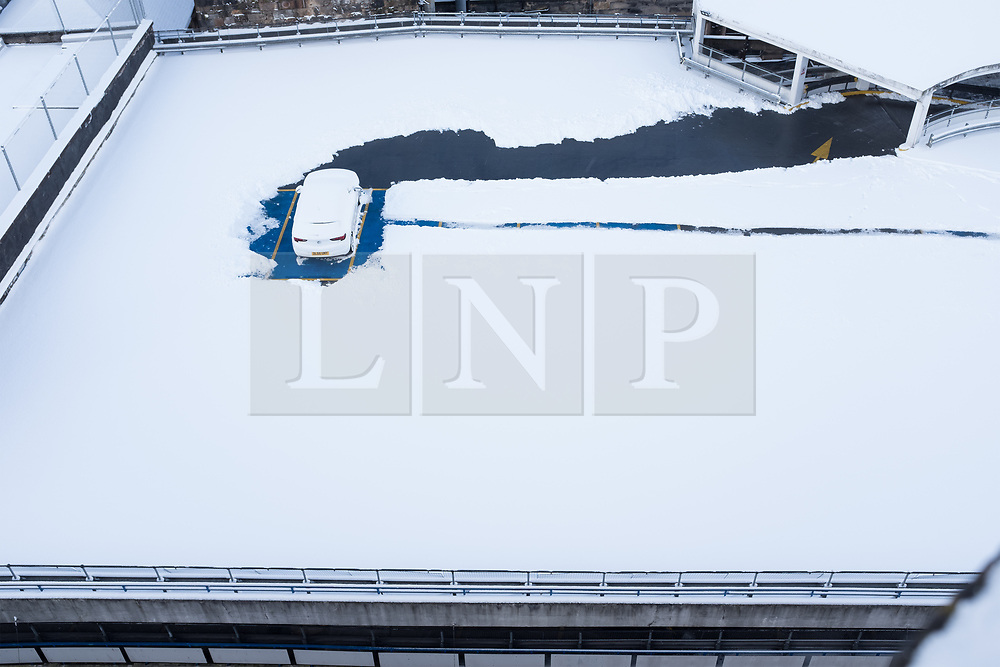 """© Licensed to London News Pictures. 28/02/2018. <br /> <br /> A single car dug pictured on the roof of a multi-storey car park in Glasgow, Scotland as the city is hit with snow storm """"Beast from the East"""" on 28th February 2018.<br /> <br /> Photo credit should read Max Bryan/LNP"""