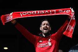 Liverpool fan shows his support prior to kick-off