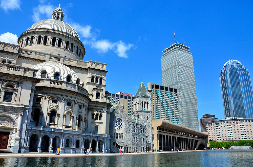 First Church of Christ, Scientist and Back Bay Skyline in Boston, Massachusetts<br /> On the left is the Mother Church of the Christian Science Church in Boston, Massachusetts.  This granite domed structure with a 126 foot steeple is called the Extension and was added to the complex in 1906.  The First Church of Christ, Scientist, is seen across the Christian Science Plaza reflection pool.  In the background is the historic Back Bay neighborhood.