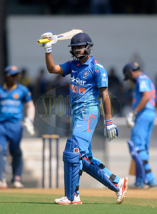 Manish Pandey of India acknowledges teammates after scoring a century during the practice match between India A and Sri Lanka held at the CCI Stadium, Mumbai,  India on the 30th October 2014<br /> <br /> Photo by:  Pal Pillai/ Sportzpics/ BCCI