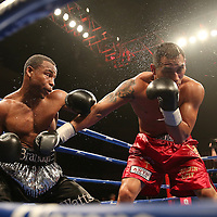 "Brandon Adams (black shorts) fights Raymond Gartica (red shorts) during the ESPN ""Boxcino"" boxing tournament at Turning Stone Resort Casino on Friday, April 18, 2014 in Verona, New York.  (AP Photo/Alex Menendez)"