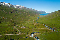 The winding road into Mjóifjörður, East fiords of Iceland. Drone aerial shot.