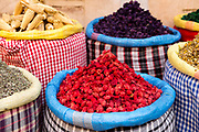 Assorted spice stand with aromatic and culinary herbs, spices and dried flowers in the Mellah, Marrakech Medina, Morocco