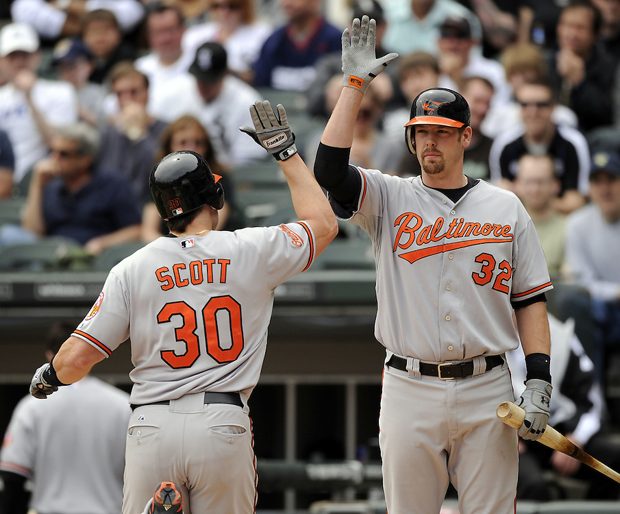 CHICAGO - MAY 01:  Luke Scott #30 is greeted by Matt Wieters #32 of the Baltimore Orioles after Scott hit a home run in the fourth inning against the Chicago White Sox on May 01, 2011 at U.S. Cellular Field in Chicago, Illinois.  The Orioles defeated the White Sox 6-4.  (Photo by Ron Vesely)  Subject:   Luke Scott;Matt Wieters