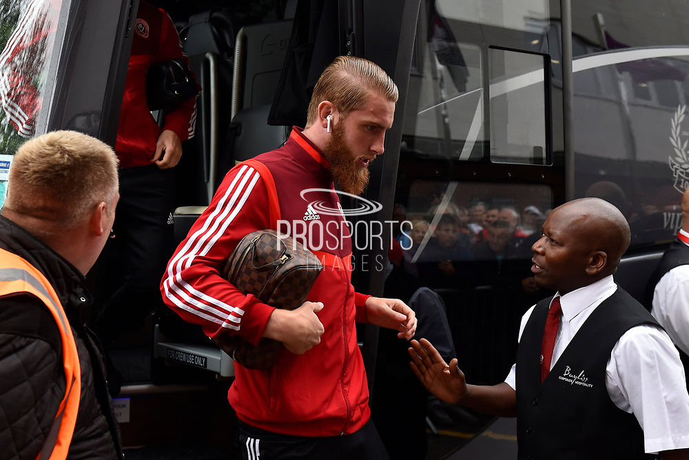 Oli McBurnie (9) of Sheffield United gets off the team bus on arrival at the Vitality Stadium ahead of the Premier League match between Bournemouth and Sheffield United at the Vitality Stadium, Bournemouth, England on 10 August 2019.
