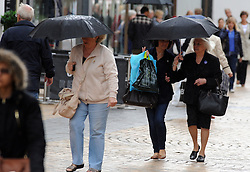 © Licensed to London News Pictures. 04/06/2014<br /> Wet Weather Bromley.<br /> Shoppers in Bromley High Street,Bromley,Kent today (04.06.2014)with umbrellas up again for the wet weather.<br /> Photo credit :Grant Falvey/LNP