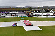 Rain Stops Play - Covers are still on as light rain continues to fall but a groundman is out with the mopping up maching clearing the water from the covers during the Specsavers County Champ Div 1 match between Somerset County Cricket Club and Essex County Cricket Club at the Cooper Associates County Ground, Taunton, United Kingdom on 23 September 2019.