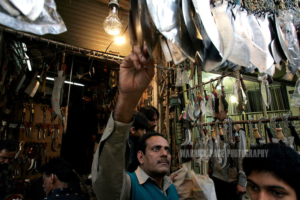 LAHORE, PAKISTAN - JANUARY 29: Shiite Muslims inspect the quality of blades used for self-flagelation during Ashura rituals in the Old City, Lahore, Pakistan on Monday 29 January, 2007. Shiite Muslims around the world commemorate the martyrdom of the Prophet Mohammed's grandson, Imam Hussein, who was killed during the battle of Karbala, Iraq. Security has been increased throughout Pakistan due to fears of sectarian violence after suicide bombings in Islamabad and Peshawar last week claimed the lives of 15 people. (Photo by Warrick Page)