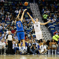 Dec 4, 2013; New Orleans, LA, USA; Dallas Mavericks power forward Dirk Nowitzki (41) shoots over New Orleans Pelicans center Jason Smith (14) during the second quarter of a game at New Orleans Arena. Mandatory Credit: Derick E. Hingle-USA TODAY Sports