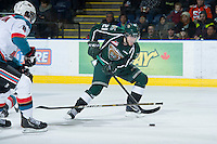 KELOWNA, CANADA - DECEMBER 30:  Joshua Winquist #21 of the Everett Silvertips skates with the puck at the Kelowna Rockets on December 30, 2012 at Prospera Place in Kelowna, British Columbia, Canada (Photo by Marissa Baecker/Shoot the Breeze) *** Local Caption ***