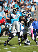 Carolina Panthers defensive end Mario Addison (97) partially blocks a first quarter pass by St. Louis Rams quarterback Sam Bradford (8) that gets intercepted and returned for a pick six touchdown by the Carolina Panthers during the NFL week 7 football game against the St. Louis Rams on Sunday, Oct. 20, 2013 in Charlotte, N.C.. The Panthers won the game 30-15. ©Paul Anthony Spinelli