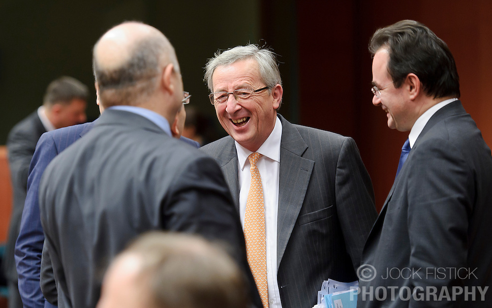 Jean-Claude Juncker, Luxembourg's prime minister, and president of the Eurogroup, center, shares a laugh with George Papaconstantinou, Greece's finance minister, right, and other colleagues, during the Eurogroup meeting in Brussels, Monday Dec. 6, 2010.(Photo © Jock Fistick)