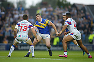 Mitch Garbutt (C) of Leeds Rhinos on the attack against Tyler Randell (L) and Reece Lyne (R) of Wakefield Trinity during the Betfred Super League match at Emerald Headingley Stadium, Leeds<br /> Picture by Stephen Gaunt/Focus Images Ltd +447904 833202<br /> 13/07/2018