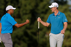 September 22, 2018 - Atlanta, Georgia, United States - Tiger Woods (L) and Justin Rose fist bump on the 17th green during the third round of the 2018 TOUR Championship. (Credit Image: © Debby Wong/ZUMA Wire)
