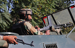 October 3, 2016 - Srinagar, Jammu and Kashmir, India - Indian troopers taking position in armored vehicle near base camp which was attacked by suspected militants at Baramulla on Oct 03 Indian controlled Kashmir. Suspected militants attacked an Indian army camp in the Indian portion of Kashmir ensuing a gunfight on late evening on Sunday, which ended in the wee hours of Monday morning, police said. (Credit Image: © Umer Asif/Pacific Press via ZUMA Wire)