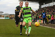 Forest Green Rovers Joseph Mills(23) holds off Yeovil Towns Craig Alcock(24) during the EFL Sky Bet League 2 match between Forest Green Rovers and Yeovil Town at the New Lawn, Forest Green, United Kingdom on 16 February 2019.
