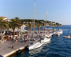People, eateries, and a variety of boats enliven Hvar's Riva promenade, a popular Croatian cruise port.