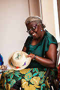 A basket maker weaves a straw hat at the Straw Market in Nassau, Bahamas.