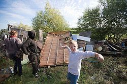 © Licensed to London News Pictures. 19/09/2011. Crays Hill, UK. A  young traveller helps to barricade the exterior of Dale Farm today (19/09/2011).  Activists and residents at the Dale Farm travellers site in Essex prepare for the council to enforce an eviction notice which is due to start today (19/09/2011). Photo credit: Ben Cawthra/LNP