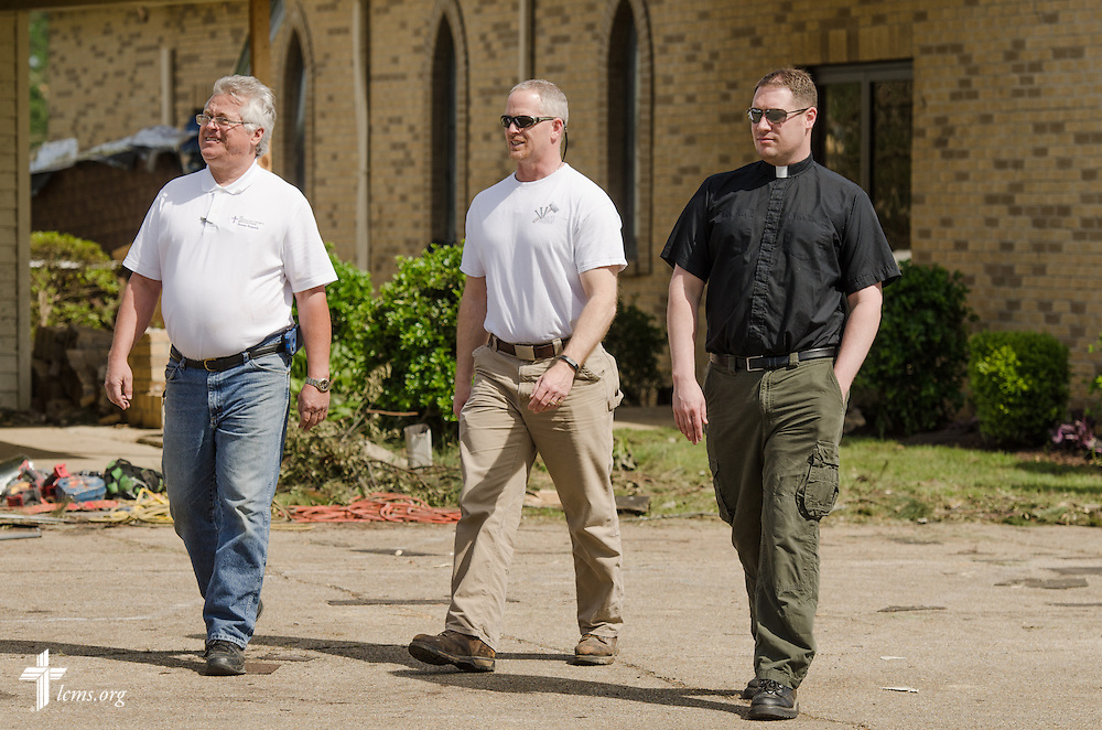 The Rev. Michael Meyer (right), manager of LCMS Disaster Response, surveys the grounds of Holy Trinity Lutheran Church with LCMS Southern District Disaster Response Coordinator (DDRC), Rev. Ed Brashier (far left) in Tupelo, Miss., on Friday, May 2, 2014. A tornado ravaged the church earlier in the week.  LCMS Communications/Erik M. Lunsford