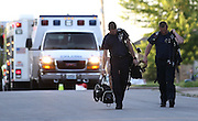 """Members of the Springfield Missouri Hazardous Materials (HAZMAT) team walk back to their vehicles with their gear after the """"all clear"""" was given. A suspicious white powder was found in an envelope in a Southwest Missouri woman's mail on May 22, 2012 in Springfield, Missouri.  (David Welker / TurfImages.com)..."""
