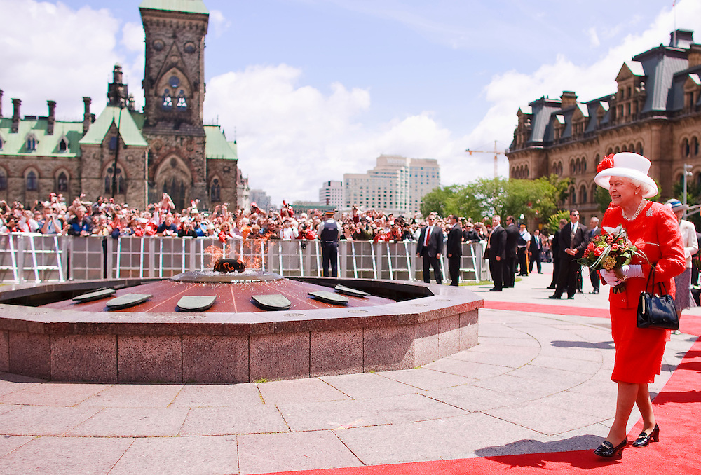Queen Elizabeth II walks past the Centennial Flame on Parliament Hill during Canada Day celebrations in Ottawa, Ontario, July 1, 2010. The Queen is on a 9 day visit to Canada. <br /> AFP/GEOFF ROBINS/STR
