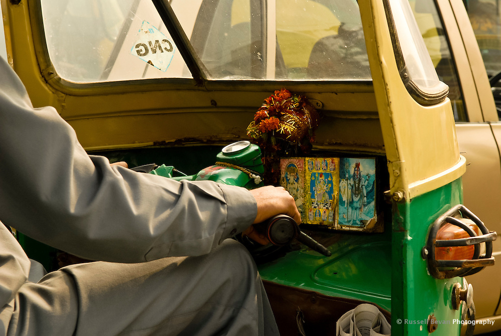 A close up of a auto  rickshaw drivers handlebars as he navigates the busy Delhi Streets, India