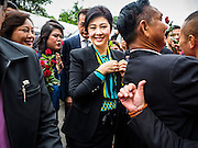 05 AUGUST 2016 - BANGKOK, THAILAND:  YINGLUCK SHINAWATRA arrives the Supreme Court of Thailand Friday. She appeared in court to start her legal defense. She was deposed by a military coup in 2014 and is being tried on corruption and mismanagement charges related to a price support plan for Thai rice farmers that was instituted while she was Prime Minister. More than two years after her government was deposed by a military coup, she is still a popular figure and hundreds of her supporters packed the area around the courthouse to greet her when she arrived at the Court.       PHOTO BY JACK KURTZ
