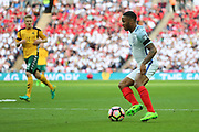 Raheem Sterling of England dribbling during the FIFA World Cup Qualifier group stage match between England and Lithuania at Wembley Stadium, London, England on 26 March 2017. Photo by Matthew Redman.